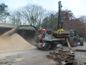Chipping timber for biomass boilers